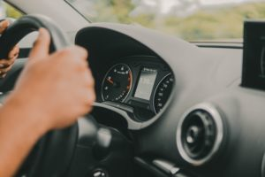 Driving Without a Licence Icon   Driver's Hands on a Steering Wheel