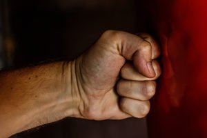 Domestic Violence Icon - Clenched Fist Punching a Wall