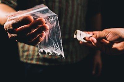 Drug Offences Icon | Drug Deal in Progress